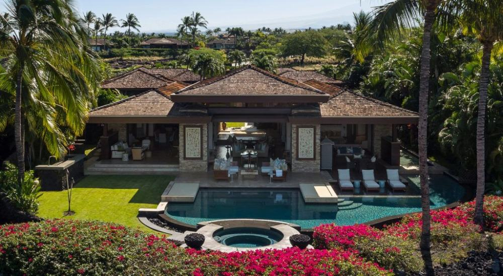 Aerial view of the house featuring its open floor plan space and its gorgeous outdoor amenities.