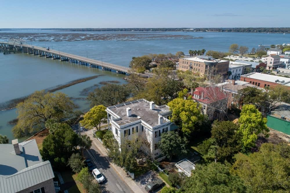 This aerial shot reveals just how close the house is to the beautiful river across the street. Images courtesy of Toptenrealestatedeals.com.
