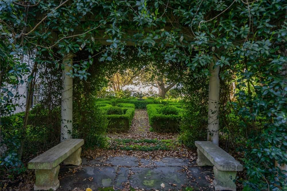 From this lawn of grass is a beautiful archway of shrubbery flanked with stone benches. Images courtesy of Toptenrealestatedeals.com.