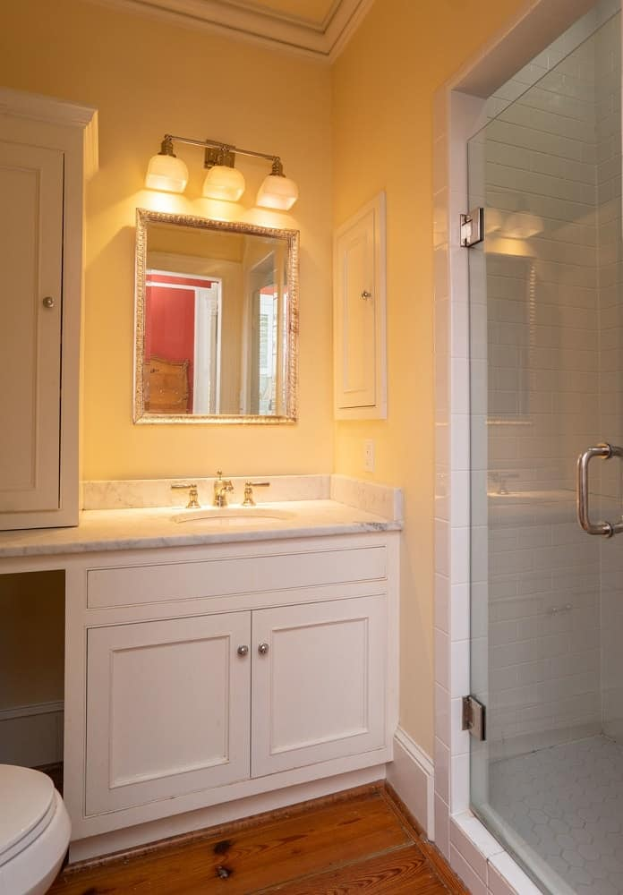 This small bathroom has a simple white wooden vanity beside the glass door of the walk-in shower area. Images courtesy of Toptenrealestatedeals.com.
