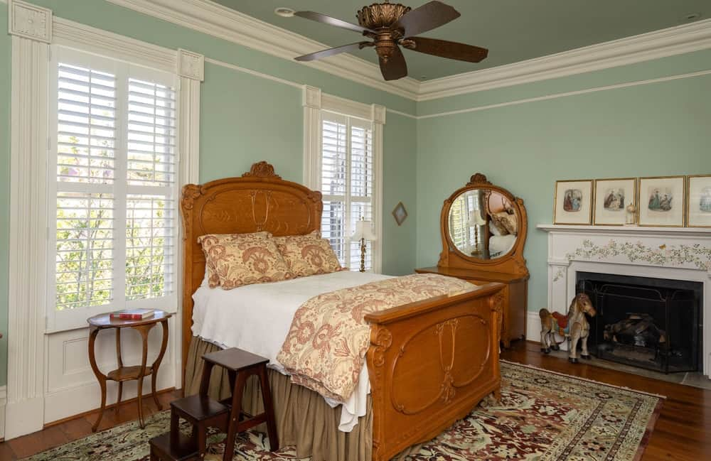 The pastel wall color is also a perfect match for the wooden mission-style bed that has a large wooden headboard. Images courtesy of Toptenrealestatedeals.com.