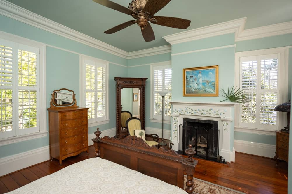 This bedroom has a cheerful pastel tone to its walls the perfectly contrasts the dark wooden flooring. Images courtesy of Toptenrealestatedeals.com.