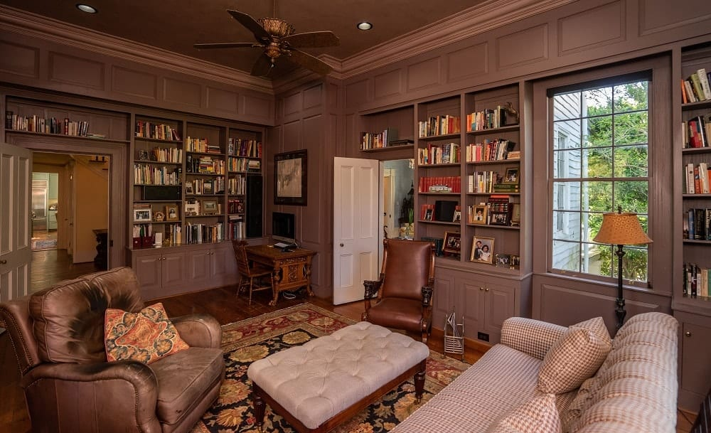 The library has a small floor space but makes up for it with a cozy vibe and a relaxing color. Images courtesy of Toptenrealestatedeals.com.
