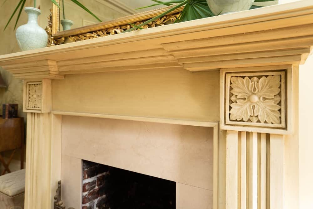 A closer look at the fireplace shows the intricate carvings on it and its amazing craftsmanship. Images courtesy of Toptenrealestatedeals.com.