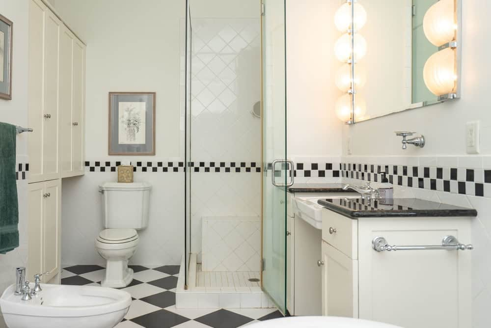 This primary bathroom has an abundance of natural lighting that plays well with the white tiles of the walls. Images courtesy of Toptenrealestatedeals.com.