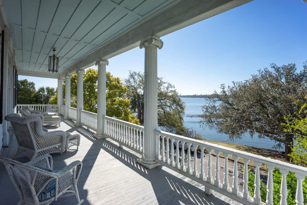The beautiful river view of the second floor balcony is complemented with tall trees. Images courtesy of Toptenrealestatedeals.com.