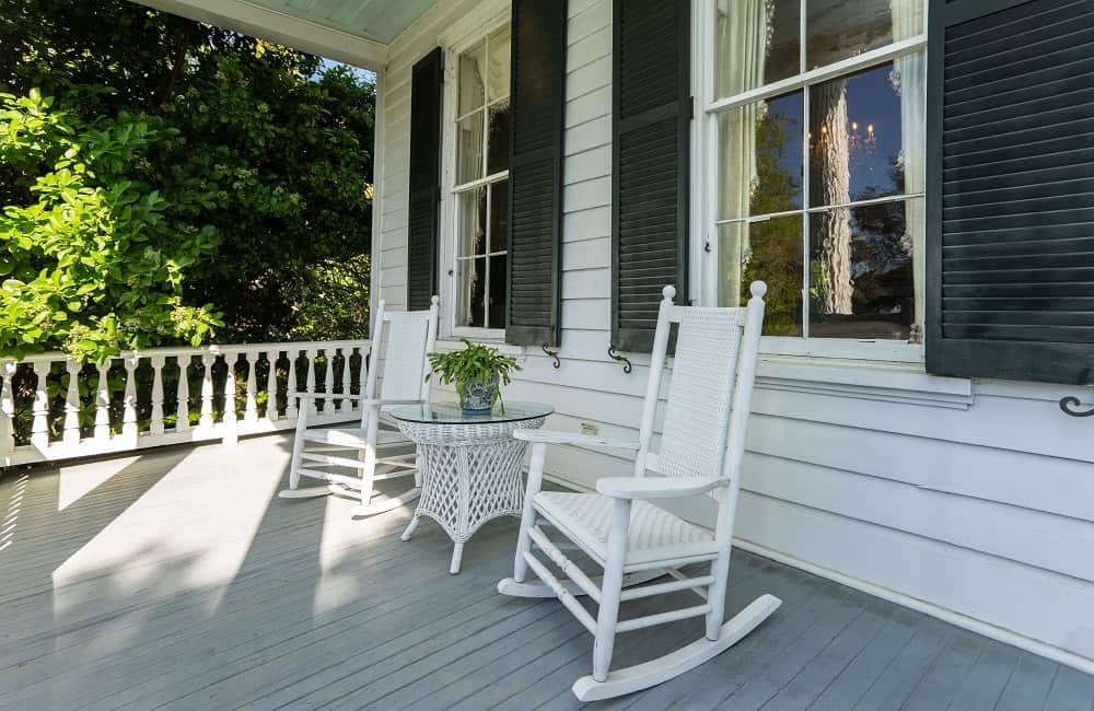 The front porch has a couple of comfortable white wooden rocking chairs perfect for enjoying the river scenery. Images courtesy of Toptenrealestatedeals.com.