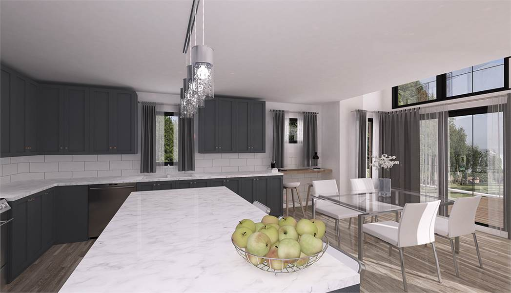 A closer view of the kitchen island shows of its white marble countertop and the informal dining area beside it. This has glass-top modern dining table to match the white modern chairs that has the same stainless steel legs as the table.