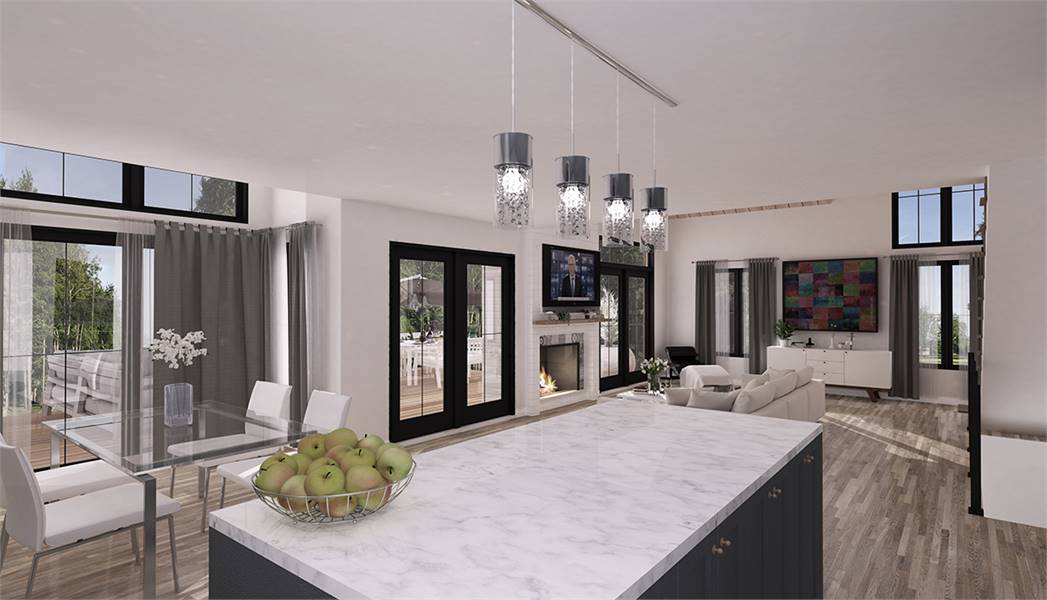 The brilliant white marble countertop is topped with four gorgeous hanging pendant lights hanging from the bright ceiling.
