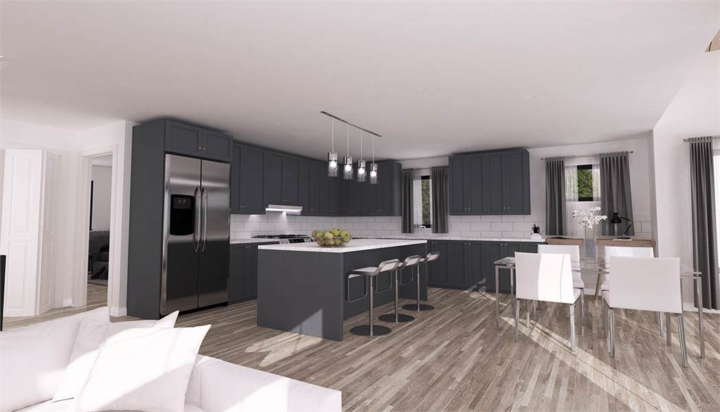 The charming kitchen has the same hardwood flooring as the rest of the house. This matches well with the matte gray cabinetry of the kitchen structures making the stainless steel appliances stand out.