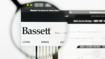 Bassett Furniture Industries Incorporated website homepage with a closer look at the logo.