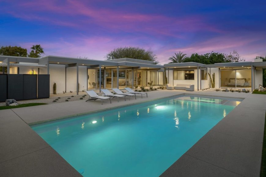 The beautiful glass and steel home has a large backyard featuring a beautiful pool surrounded by a desert landscape. Images courtesy of Toptenrealestatedeals.com.