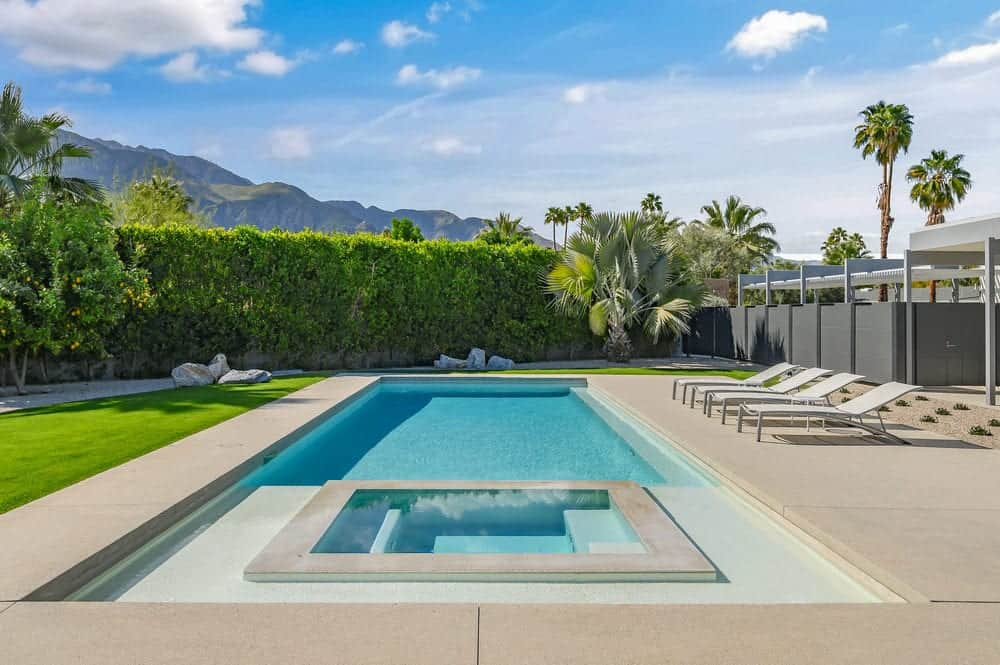 The centerpiece of the large backyard is this amazing rectangular pool with an attached small pool relaxation. Images courtesy of Toptenrealestatedeals.com.