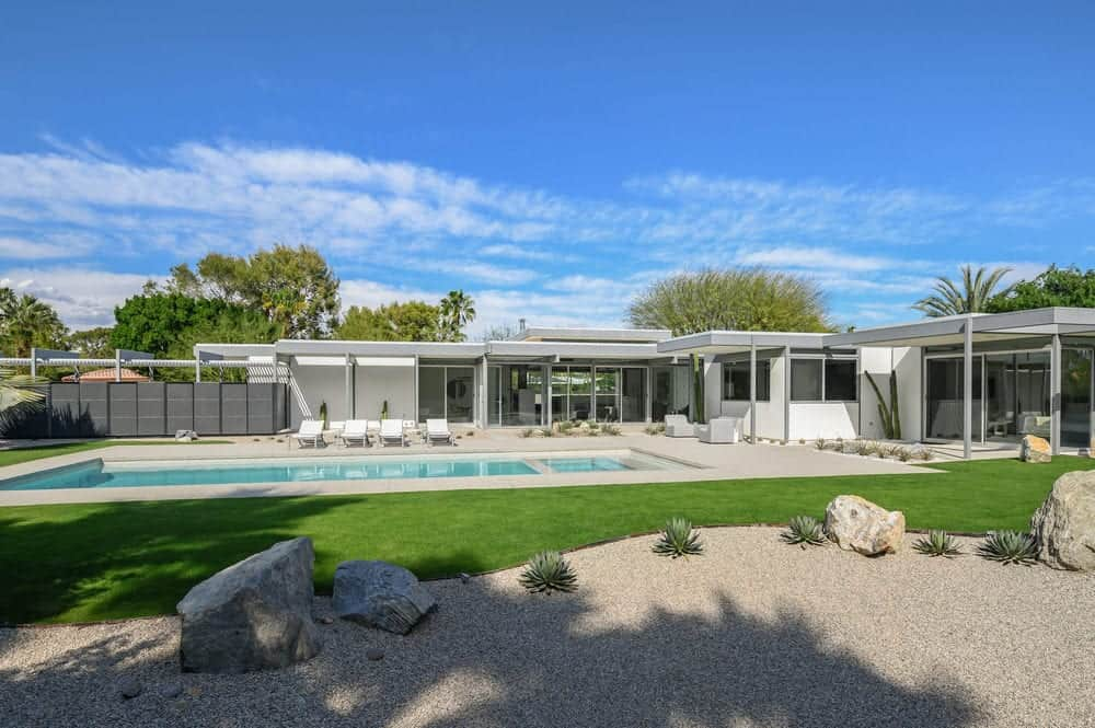The other side of the pool has a strip of grassy lawn that is well-maintained making the green tone pop out amidst the desert landscaping surrounding it. Images courtesy of Toptenrealestatedeals.com.
