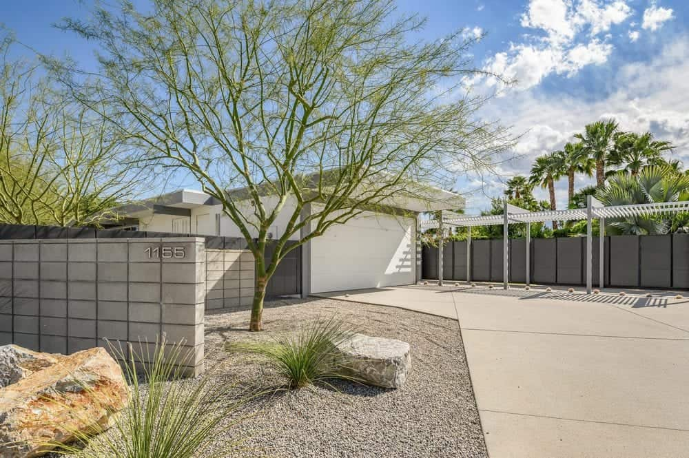 The front of the home is landscaped with a gorgeous desert aesthetic that is low maintenance and drought-resistant. Images courtesy of Toptenrealestatedeals.com.