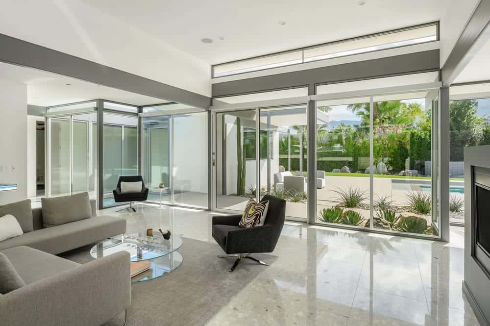The natural lights coming from the glass walls play well with the bright ceiling and the shiny flooring for a unique and clean aesthetic. Images courtesy of Toptenrealestatedeals.com.
