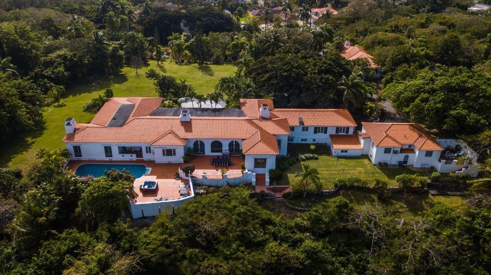 An aerial view of the house boasting its wide landscaping and gorgeous exterior design.