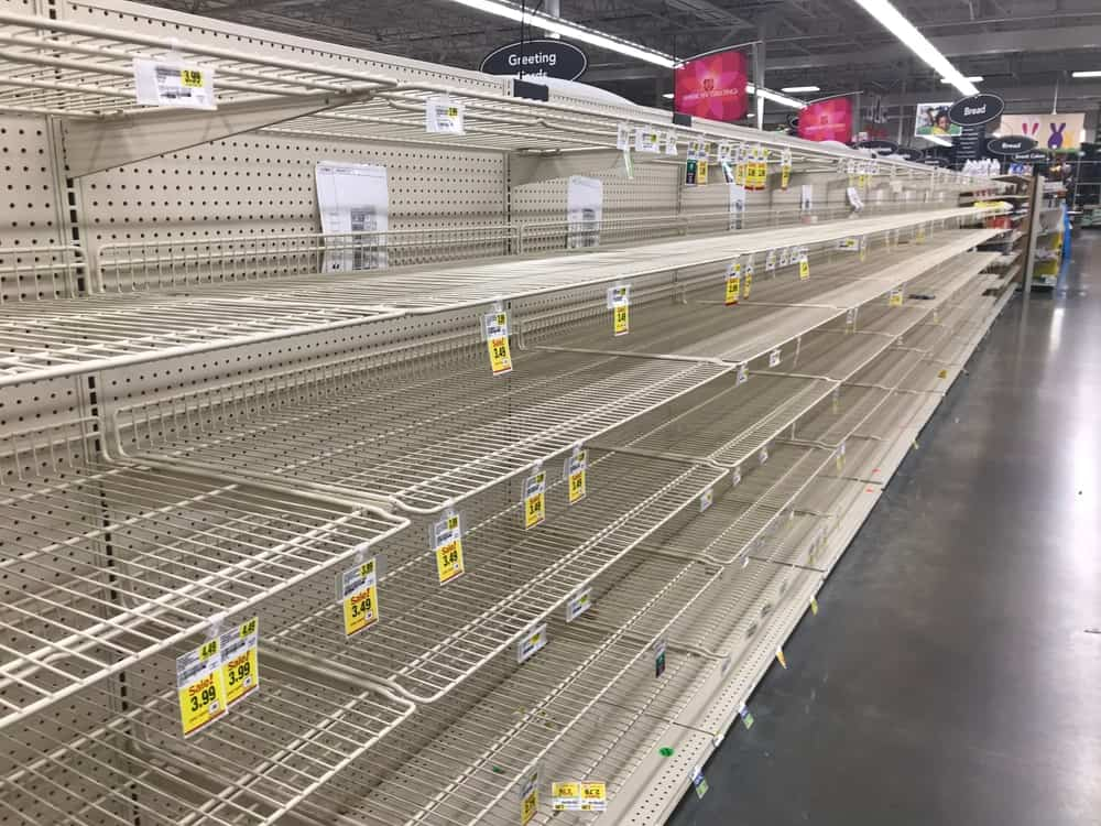 Empty bread shelves at grocery store.