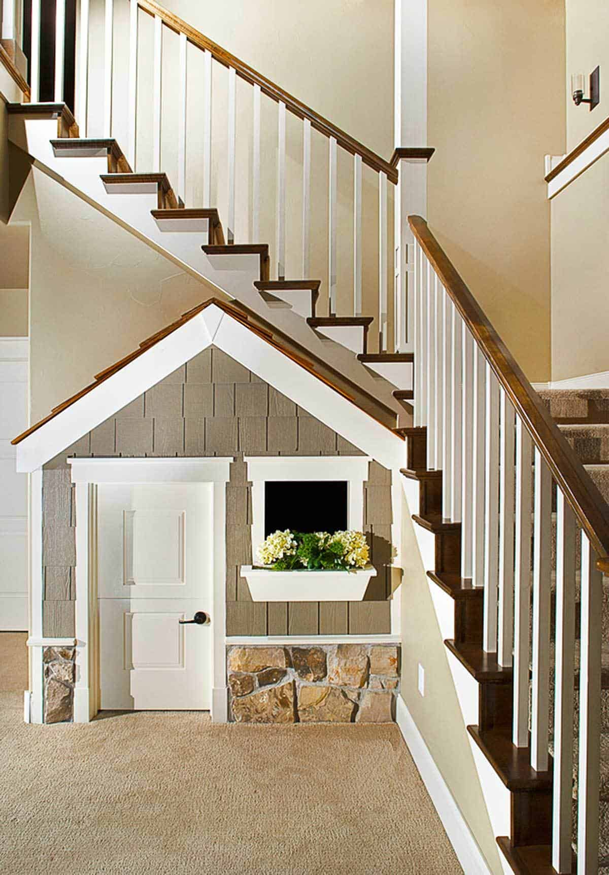 A traditional staircase on the foyer with a storage underneath designed like a little house.
