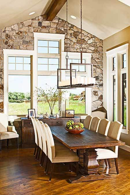 The dining area has beige upholstered chairs and a rectangular dining table matching the wooden buffet.