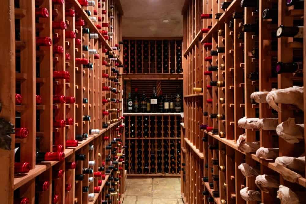 Here's the mansion's 5,500-bottle-wine room with wooden wine racks and tiles flooring. Images courtesy of Toptenrealestatedeals.com.