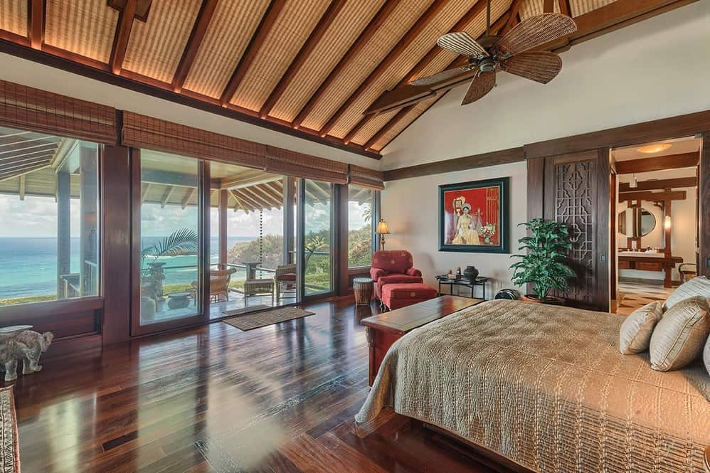 This bedroom has a dark hardwood flooring that pairs quite well with the exposed wooden beams of the shed ceiling hanging a decorative ceiling fan over the bed. Images courtesy of Toptenrealestatedeals.com.