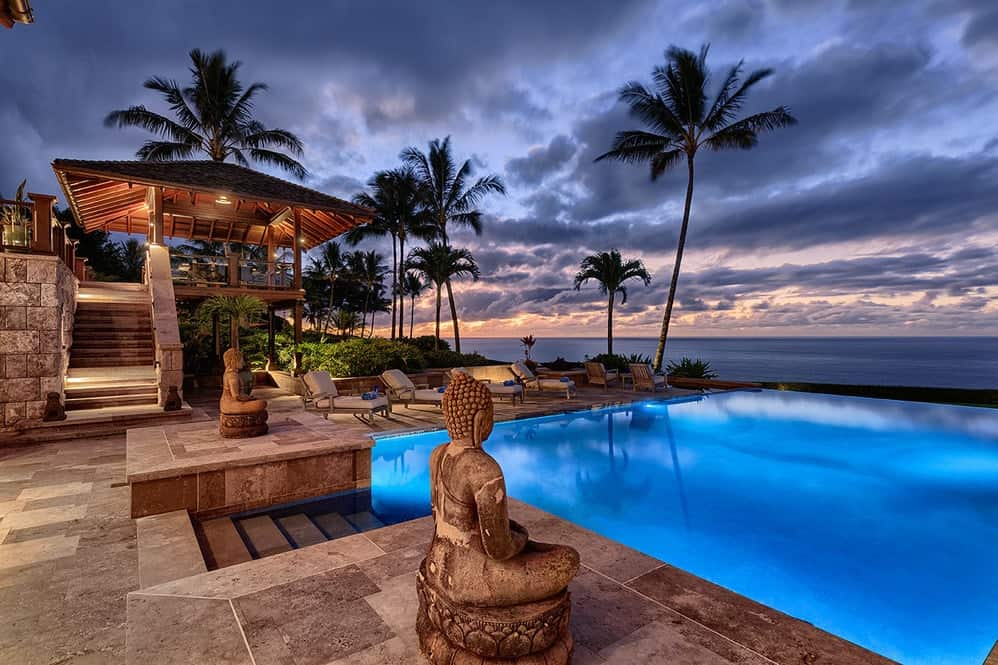 The pool has its own lighting that gives it an ethereal glow against the dark skies. The entrance to the pool is flanked by a couple of stone Buddha statues giving the area a relaxing spa-like feel augmented by the gorgeous view of the ocean. Images courtesy of Toptenrealestatedeals.com.