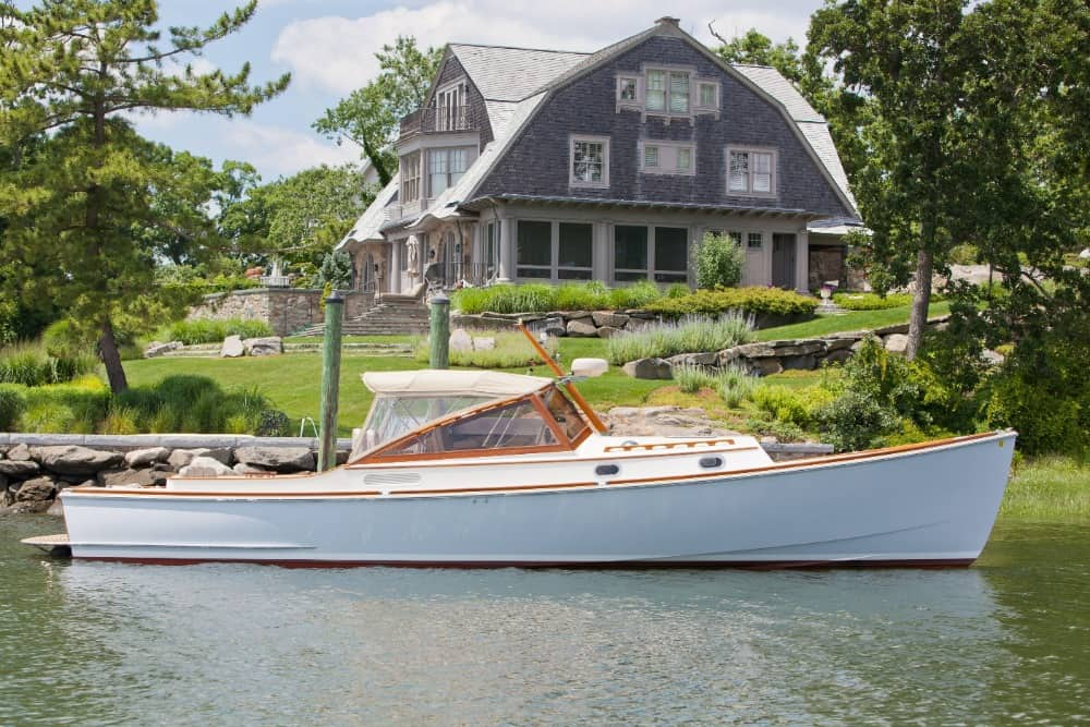 The property also offers a dock featuring this boat in a close up look. Images courtesy of Toptenrealestatedeals.com.