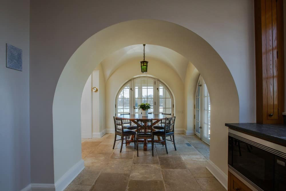 A dining nook with a round table set situated under the home's gorgeous groin vault ceiling. Images courtesy of Toptenrealestatedeals.com.