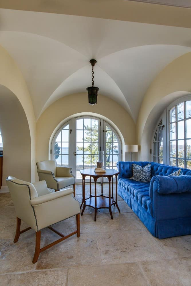 The living room offers a gorgeous sofa set with a large blue couch. Images courtesy of Toptenrealestatedeals.com.