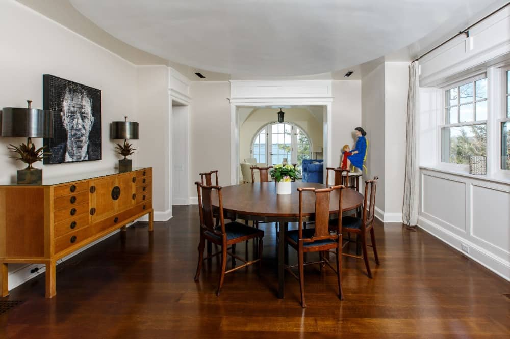 Another look at this dining area featuring white walls and well-polished hardwood flooring. Images courtesy of Toptenrealestatedeals.com.