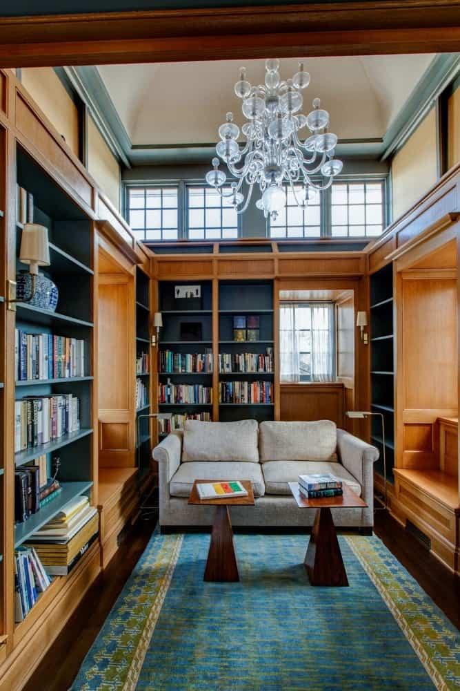 The home also has a library offering a comfy couch and multiple bookshelves filled with books. Images courtesy of Toptenrealestatedeals.com.