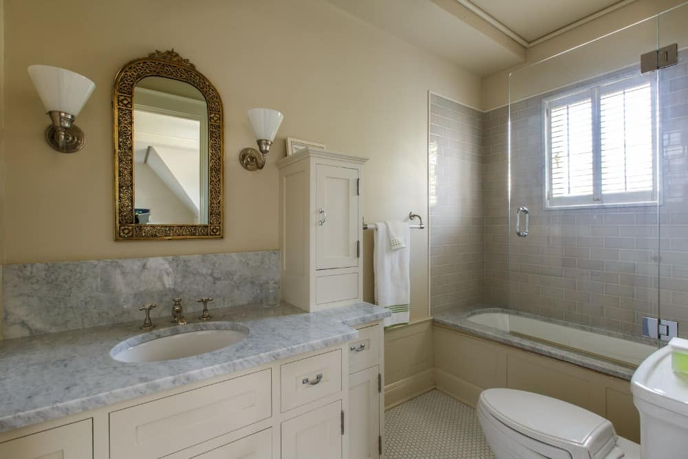 A bathroom inside a bedroom suite. It features a nice sink counter along with a bathtub and shower combo. Images courtesy of Toptenrealestatedeals.com.