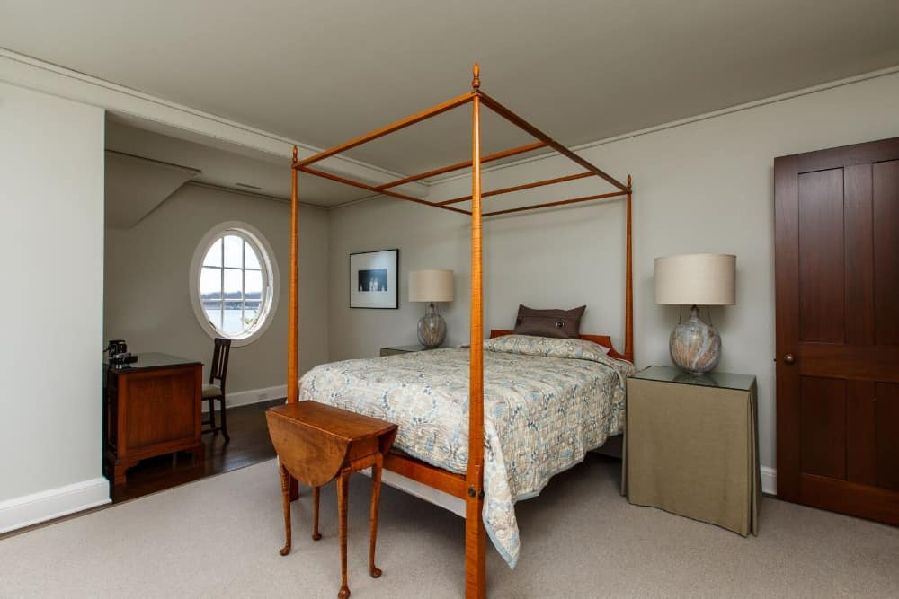 This bedroom suite offers a single bed set lighted by table lamps on both sides and has a study desk on the side. Images courtesy of Toptenrealestatedeals.com.