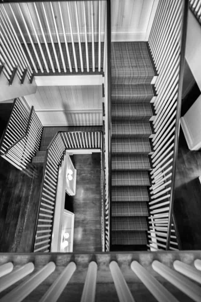 A focused look at the home's staircase in black and white for a dramatic feel. Images courtesy of Toptenrealestatedeals.com.