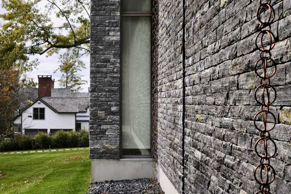 A closer view at the stone exterior of the house, along with its glass windows. Images courtesy of Toptenrealestatedeals.com.