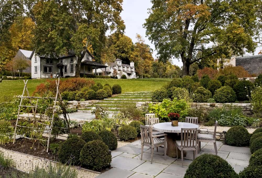 A patio in the home's garden, surrounded by the lovely greenery. Images courtesy of Toptenrealestatedeals.com.