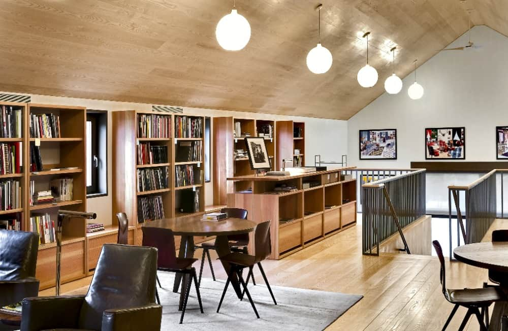 The second floor offers a large library area with multiple tables and chairs set along with multiple built-in bookshelves. Images courtesy of Toptenrealestatedeals.com.