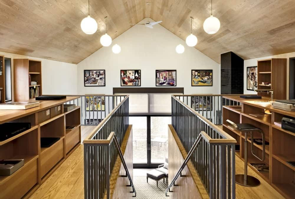 This is the home's second floor landing with built-in tables and shelves on both sides. Images courtesy of Toptenrealestatedeals.com.