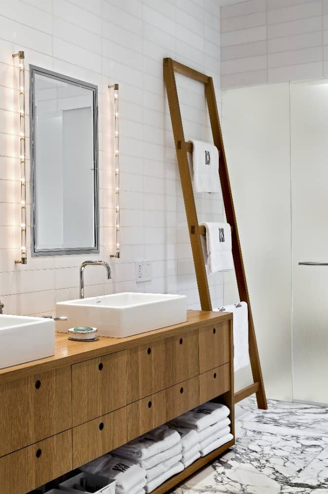 The bathroom also offers a wooden sink counter offering two large vessel sinks. Images courtesy of Toptenrealestatedeals.com.