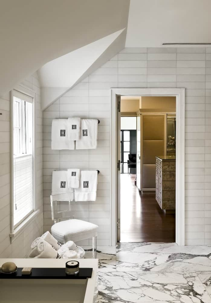 This bathroom boasts its gorgeous white marble tiles flooring. Images courtesy of Toptenrealestatedeals.com.