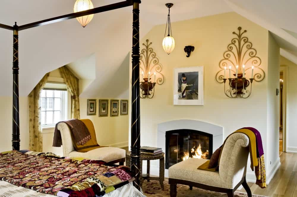 The bedroom also has a sitting area with two chairs and a center table set near the white fireplace. Images courtesy of Toptenrealestatedeals.com.