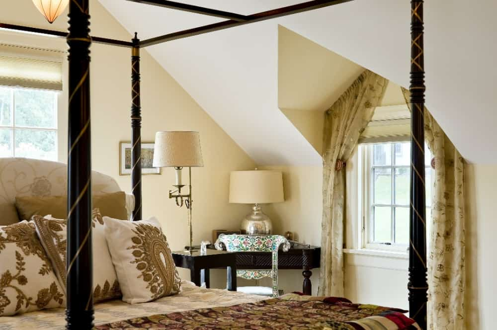 The primary bedroom offers a large bed set that is very classy, set under the room's custom ceiling. Images courtesy of Toptenrealestatedeals.com.