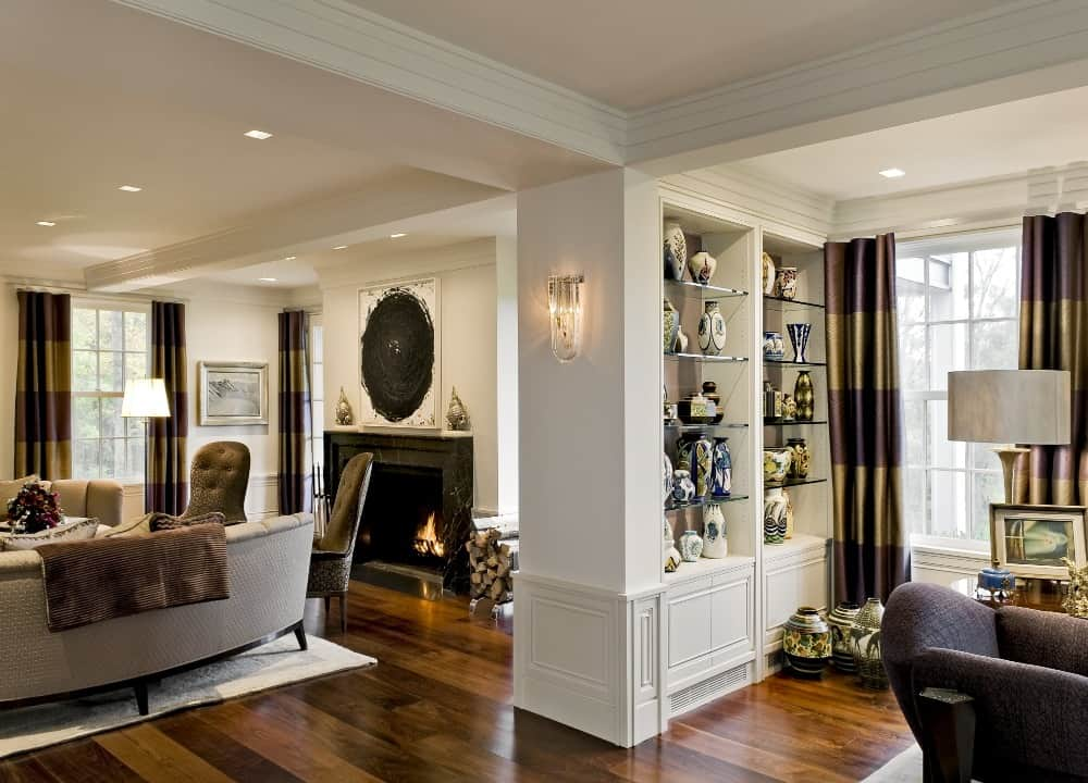 The living space boasts luxurious sofa set with a large magnificent fireplace. Images courtesy of Toptenrealestatedeals.com.