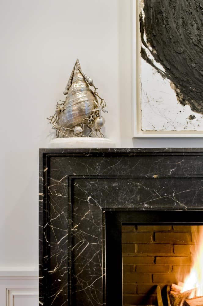 A focused look at the living room's marble tiles fireplace. Images courtesy of Toptenrealestatedeals.com.