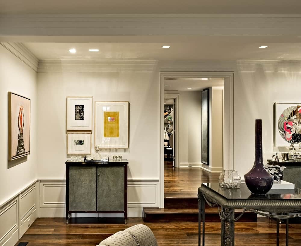 The home features white walls and a custom white ceiling lighted by recessed ceiling lights. Images courtesy of Toptenrealestatedeals.com.
