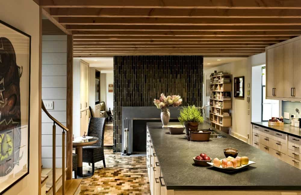 Kitchen with a large center island boasting a striking black countertop similar with the kitchen counter. Images courtesy of Toptenrealestatedeals.com.