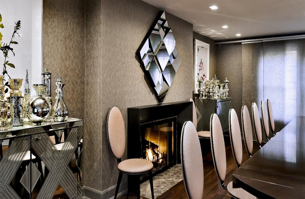 Dining room boasting an elegant dining table and chairs set surrounded by very attractive walls. There's also a magnificent fireplace on the side. Images courtesy of Toptenrealestatedeals.com.