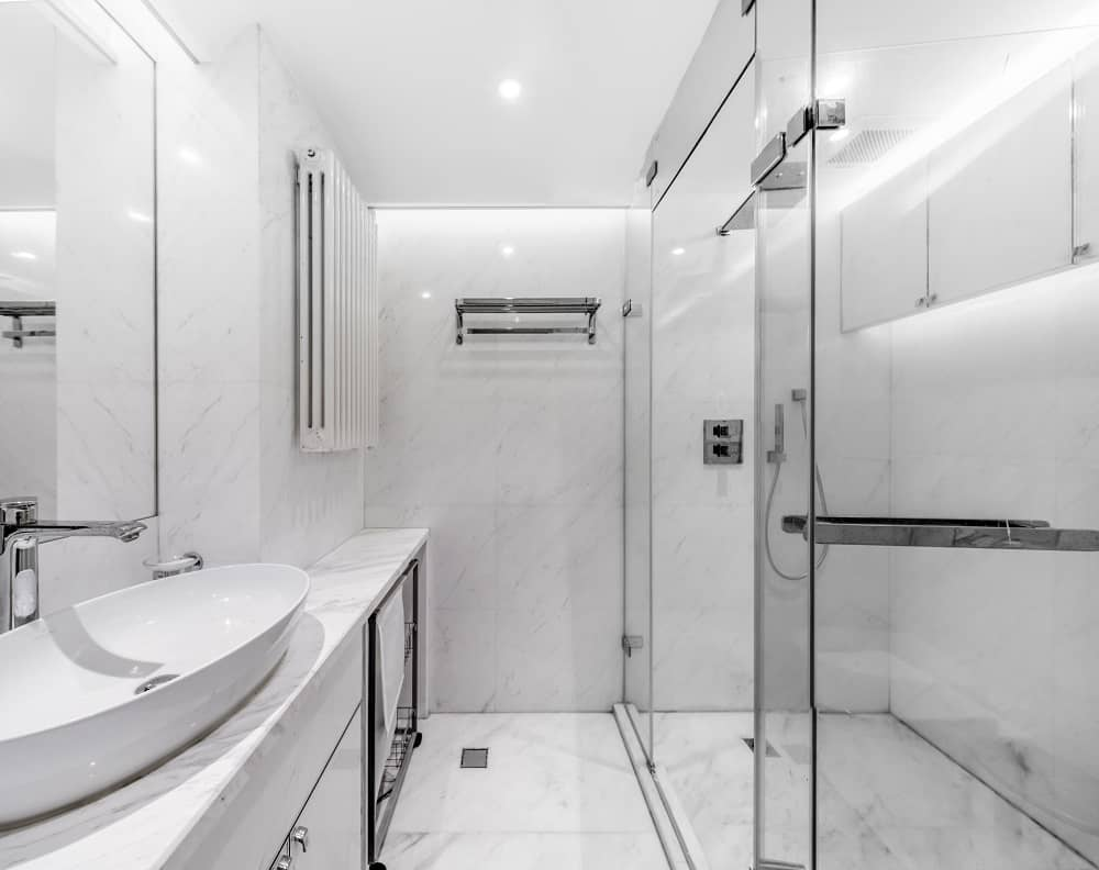 Bathroom in the Home Space with Two Kids designed by Atelier Alter.
