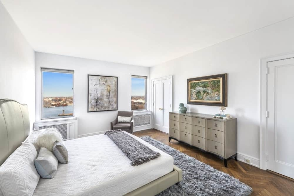 The other bedroom is also festooned with decrative wall artworks that complement the bright walls and simple dresser. Images courtesy of Toptenrealestatedeals.com.